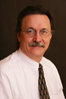 Dr. Curren Warf, Division Head